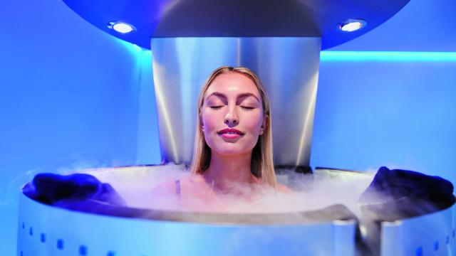 Portrait of happy young woman in a whole body cryotherapy cabin with her eyes closed. Cryosauna chamber for overall increase in muscular performance.; Shutterstock ID 452485297